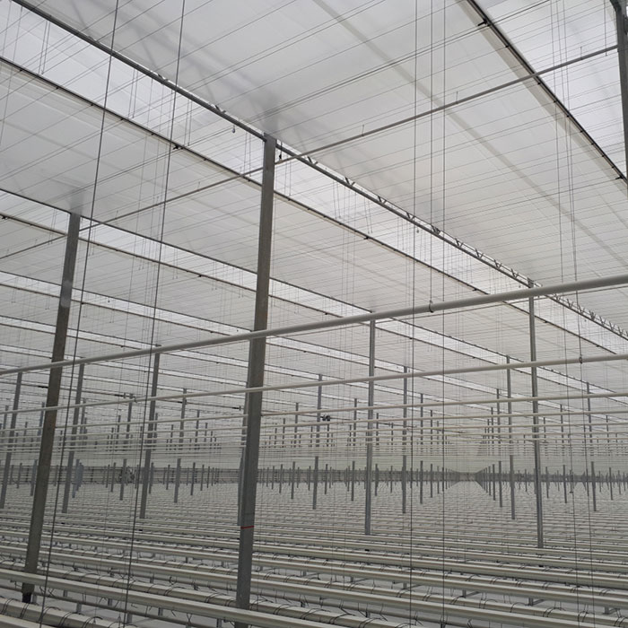 Commercial greenhouse shade systems and shade system designs